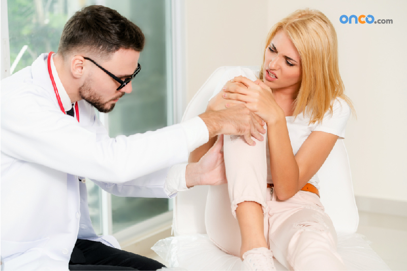 Picture of a patient with joint pain being examined by doctor