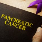 Picture of a book with the words pancreatic cancer written on it