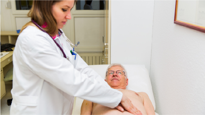 Picture of a doctor examining a patient for liver cancer