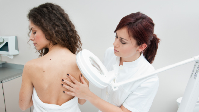 Picture of a doctor diagnosing the patient for skin cancer