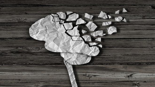 Picture of crumbled papers forming into a brain